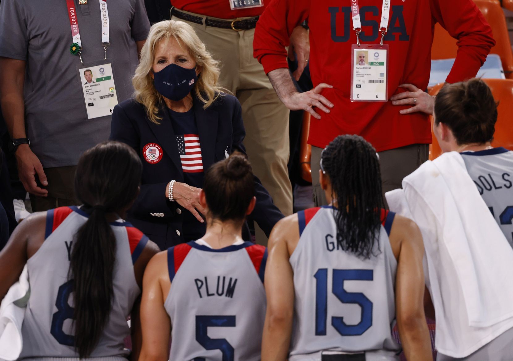 First lady Jill Biden talks with USA's Jacquelyn Young (8), Kelsey Plum (5), Allisha Gray (15) and Stefanie Dolson (13) after their victory over France 17-10 in a 3x3 women's basketball game during the postponed 2020 Tokyo Olympics at Aomi Urban Sports Park on Saturday, July 24, 2021, in Tokyo, Japan. (Vernon Bryant/The Dallas Morning News)