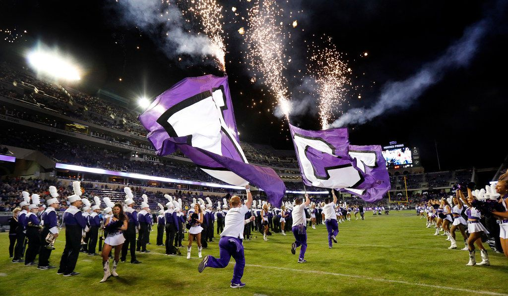 The TCU Horned Frogs cheer squad races onto the field ahead of the football team before they faced the Oklahoma State Cowboys at Amon G. Carter Stadium in Fort Worth, Texas, Saturday, November 24, 2018. The Frogs hung onto win, 31-24. (Tom Fox/The Dallas Morning News)