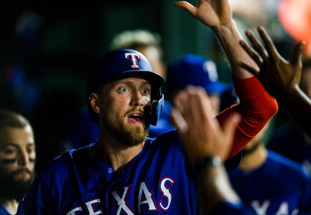 Texas Rangers designated hitter Hunter Pence (24) celebrates a run in the dugout during the sixth inning of an MLB game between the Texas Rangers and the Seattle Mariners on Tuesday, May 21, 2019 at Globe Life Park in Arlington. (Ashley Landis/The Dallas Morning News