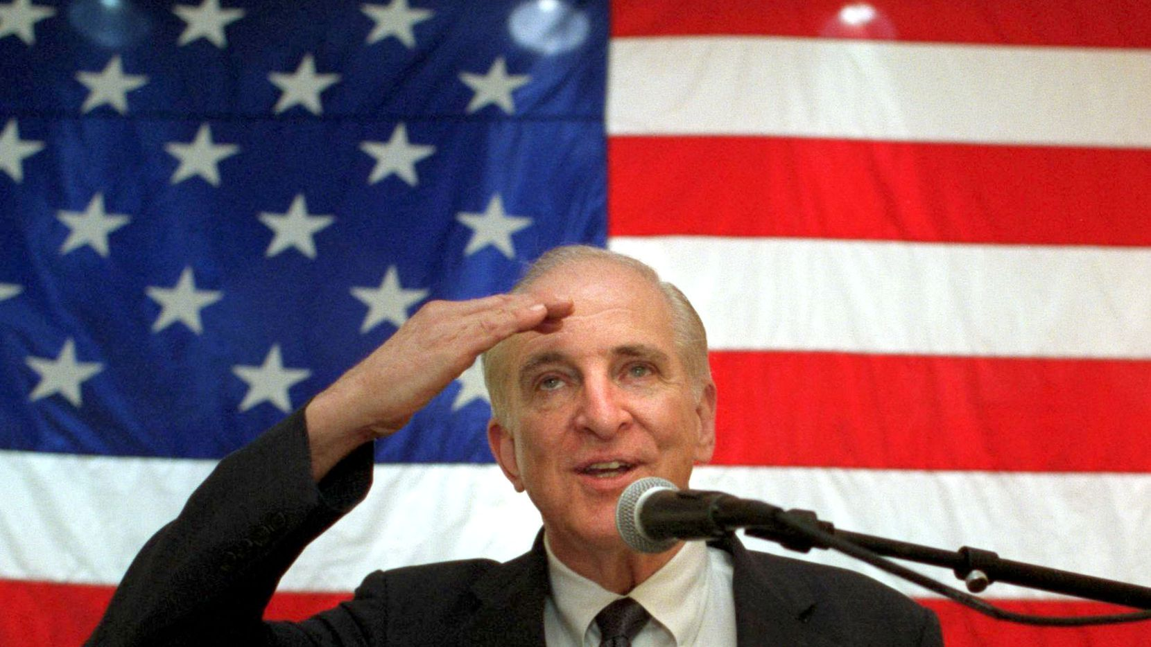 (6/24/01) - Congressman Sam Johnson, a Veteran of the Korean War and the Vietnam War, salutes the crowd of Korean War veterans and family members after he spoke to them during a 50th anniversary commemoration of the Korean War at the Dallas VA Medical Center in June 2001.  Johnson was a POW in Vietnam for 7 years.