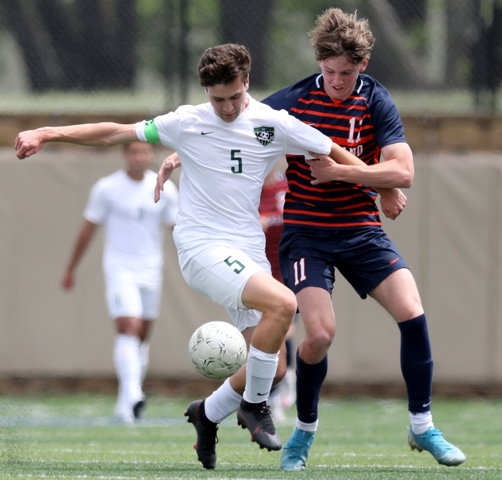 Frisco Wakeland's William Heidman (11) and Humble Kingwood Park's Brandon Rogers (5) struggle for control of the ball during their UIL 5A boys State championship soccer game at Birkelbach Field on April 17, 2021 in Georgetown, Texas.