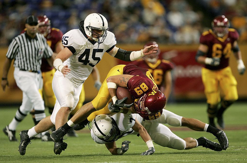 MINNEAPOLIS, MN - OCTOBER 07:  Tight end Matt Spaeth #89 of the Minnesota Golden Gophers is tackled by Anthony Scirrotto #7 and Sean Lee #45 of the Penn State Nittany Lions as Penn State defeated Minnesota 28-27 in overtime on October 7, 2006 at the Metrodome in Minneapolis, Minnesota.  (Photo by Doug Pensinger/Getty Images)