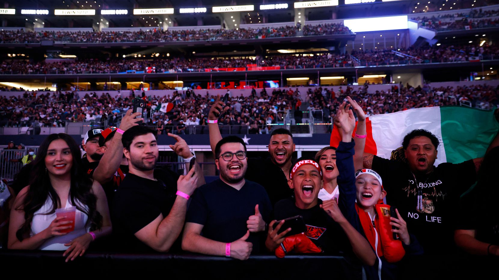 Elwin Soto of Baja California, Mexicoand Katsunari Takayama of Osaka, Japan is introduced before a large crowd watching the WBO World Light-Flyweight title at AT&T Stadium in Arlington, Saturday, May 8, 2021.They were waiting for the Canelo Alvarez-Billy Joe Saunders fight.