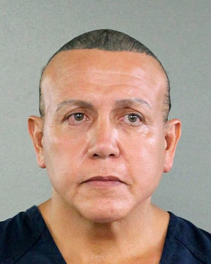 In this undated photo released by the Broward County Sheriff's office, Cesar Sayoc is seen in a booking photo in Miami. Federal authorities took  Sayoc, 56, of Aventura, Fla., into custody Friday.