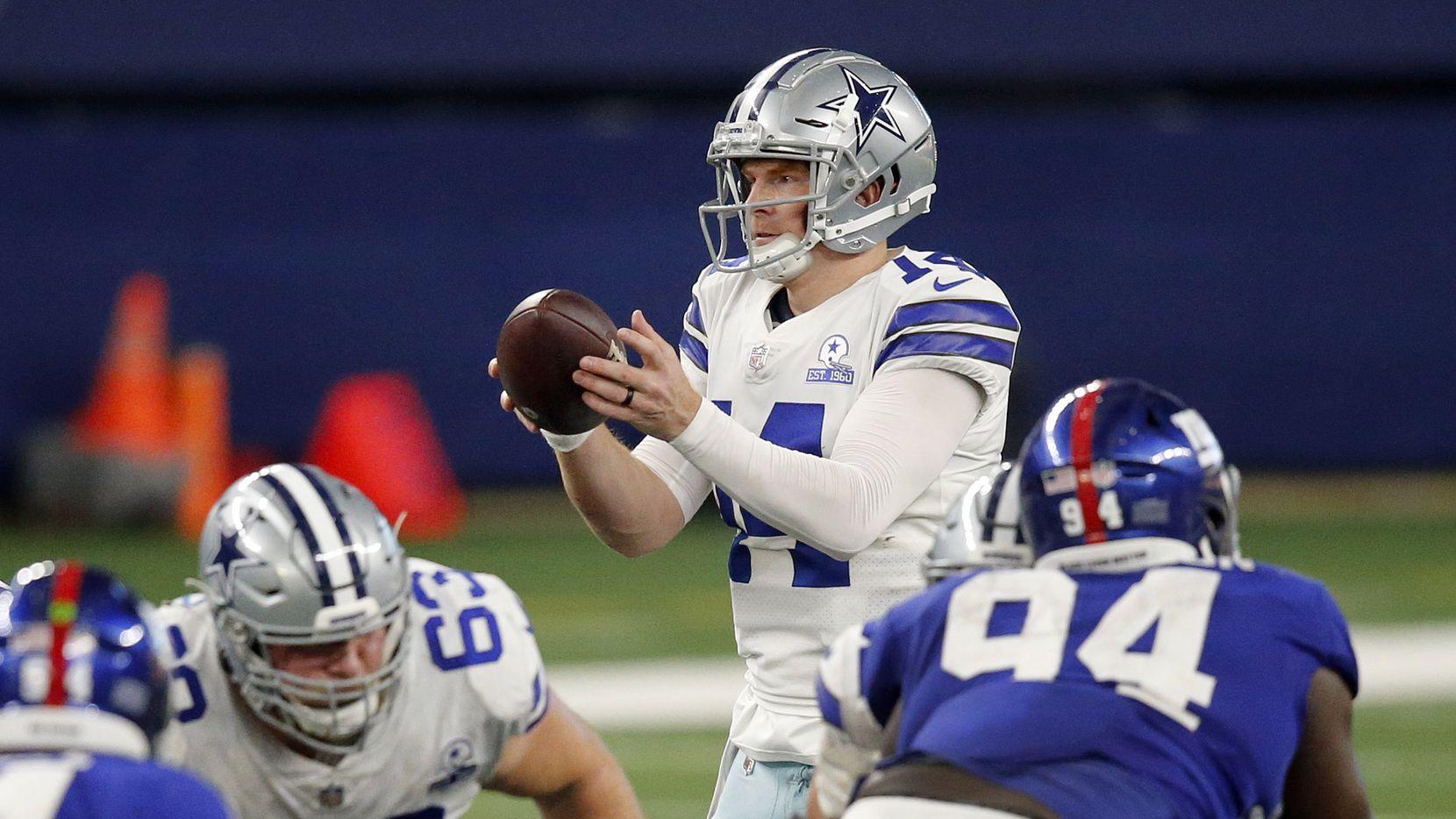 Dallas Cowboys quarterback Andy Dalton (14) takes a fourth quarter snap against the New York Giants at AT&T Stadium Stadium in Arlington, Texas, Sunday, October 11, 2020.