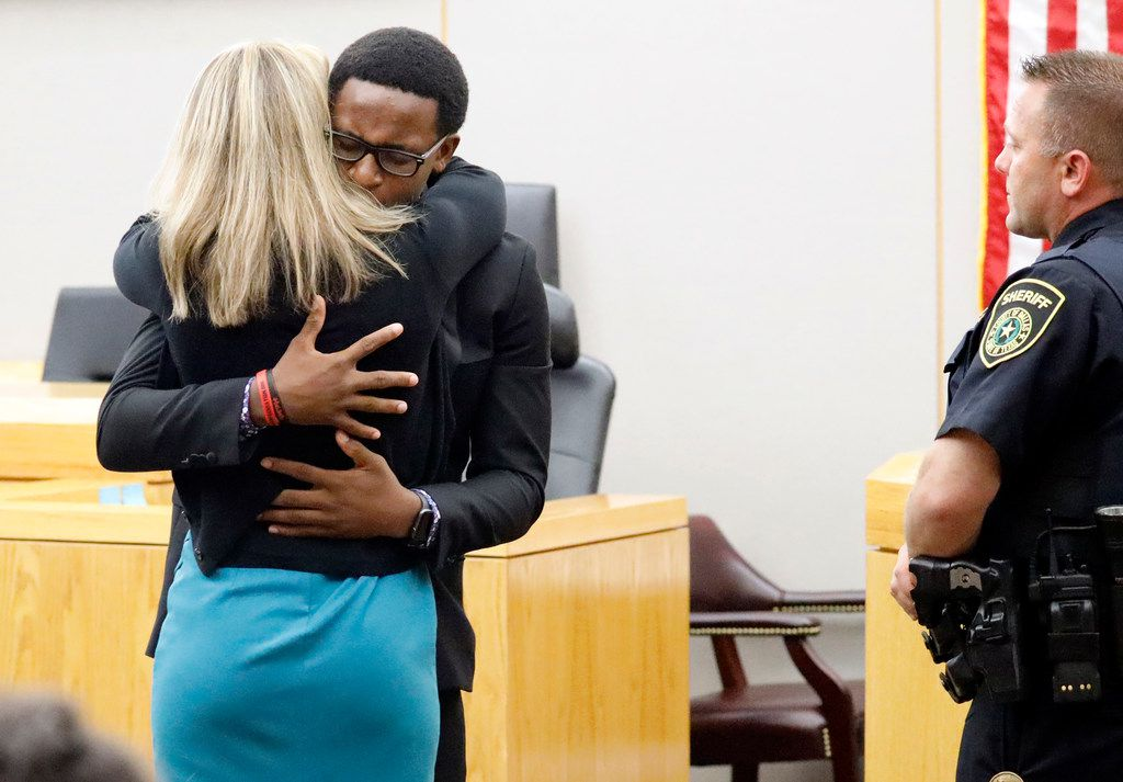 Botham Jean's younger brother Brandt Jean hugs convicted murderer Amber Guyger after delivering his impact statement to her following her 10-year prison sentence for murder at the Frank Crowley Courts Building in Dallas, Oct. 2, 2019. Brandt asked the judge if he could give Guyger a hug. The fired Dallas police officer was found guilty of murder by a 12-person jury. Guyger shot and killed Botham Jean, an unarmed neighbor in his own apartment last year. She told police she thought his apartment was her own and that he was an intruder.