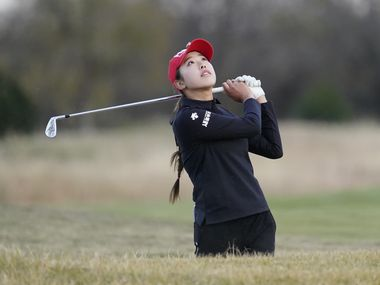 Yealimi Noh watches her shot from a sand trap on the 18th hole during the third round of the Volunteers of America Classic at the Old American Golf Club on December 5, 2020 in The Colony, Texas.