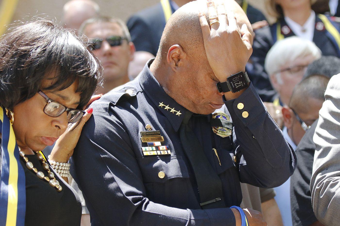 Dallas Police Chief David Brown pauses at a prayer vigil during a citywide prayer service in downtown Dallas on Friday, July 8, 2016, following the shootings during a peaceful protest on July 7, which left 5 police officers dead.