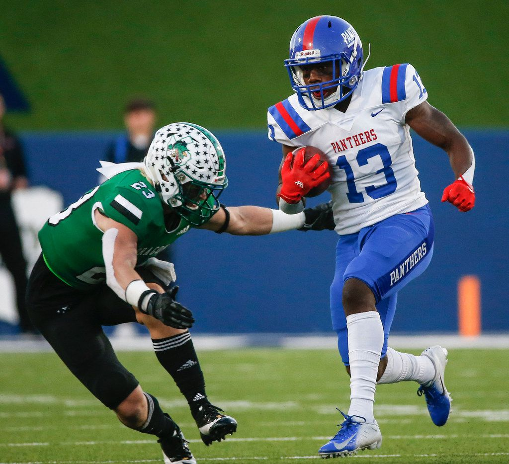 Duncanville wide receiver Roderick Daniels (13) makes a break past Southlake Carroll defensive back Beck Para (23) during the second half of a Class 6A Division I Region I high school football matchup between Southlake Carroll and Duncanville on Saturday, Dec. 7, 2019 at McKinney ISD Stadium in McKinney, Texas.
