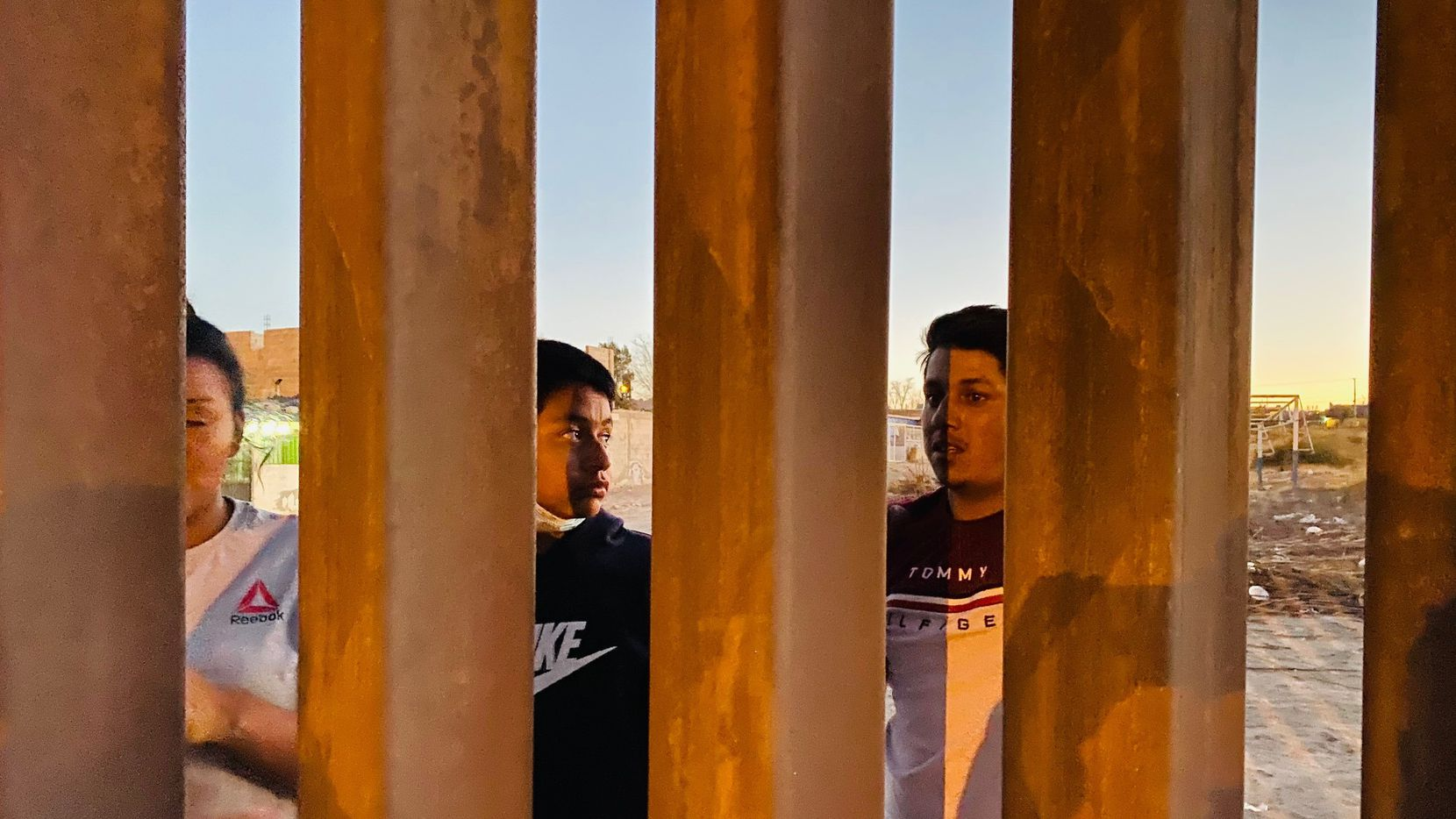 "Neighbors in Anapra, Mexico, across from Sunland Park, New Mexico, describe how migrants climb over the new border wall ""in a minute, or less."" Sometimes, they injure themselves, and such incidents are routine."