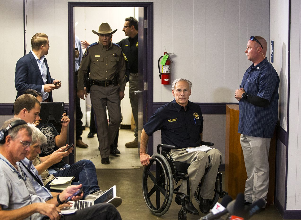 Texas Gov. Greg Abbott arrives to the Stockdale Community Center to address members of the media about a deadly shooting at the First Baptist Church in Sutherland Springs, during a press conference in Stockdale, Texas, Sunday, Nov. 5, 2017.