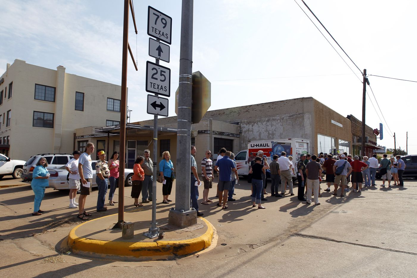 Book buyers lined up to bid on Larry McMurtry's private collection of books in downtown Archer City, in August, 2012.