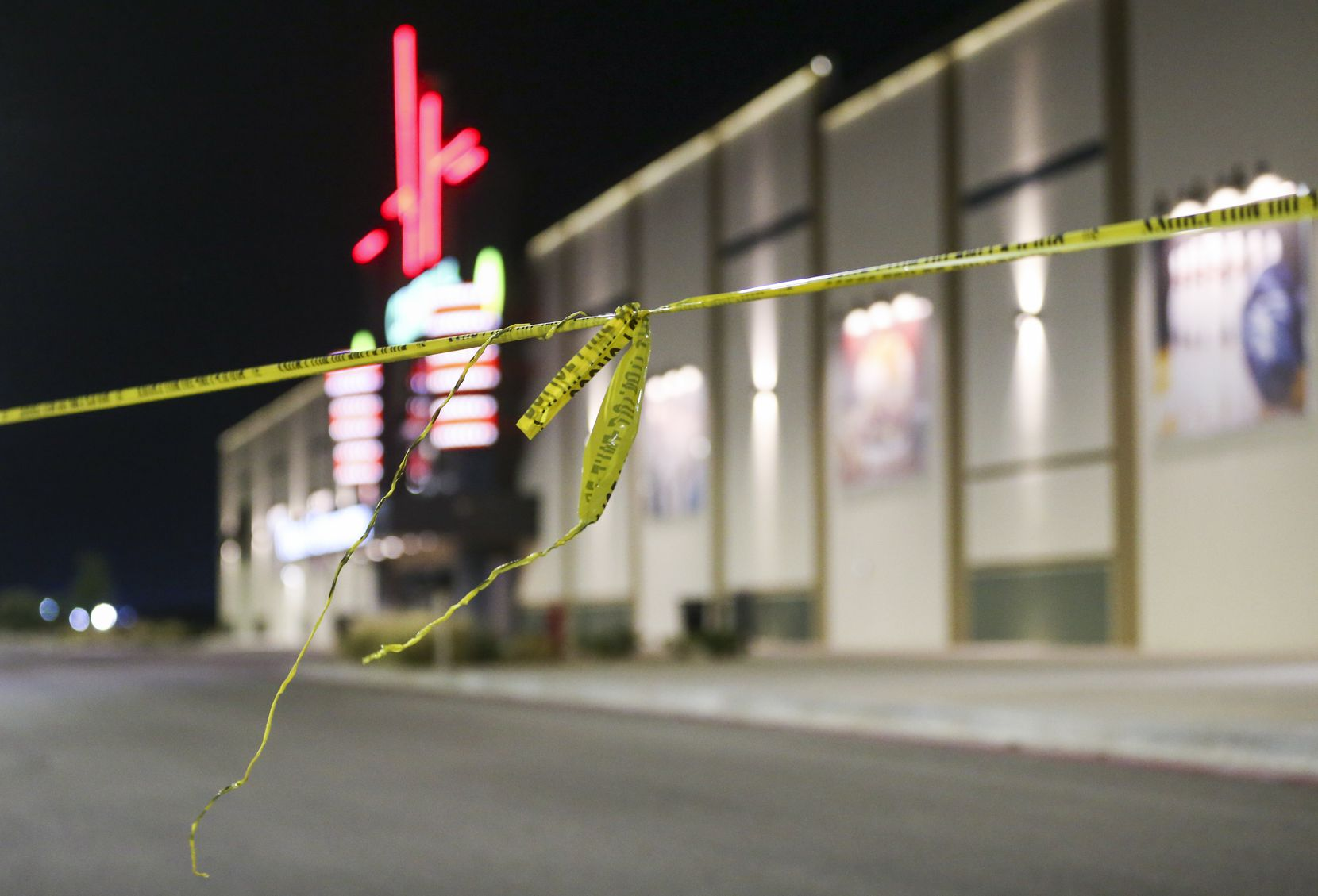 Police tape hangs at a Cinergy movie theatre Saturday, Aug. 31, 2019 in Odessa, Texas. At least five people died after more than 20 people were shot Saturday when a gunman hijacked a postal truck and began shooting randomly in the Odessa area of West Texas, authorities say.