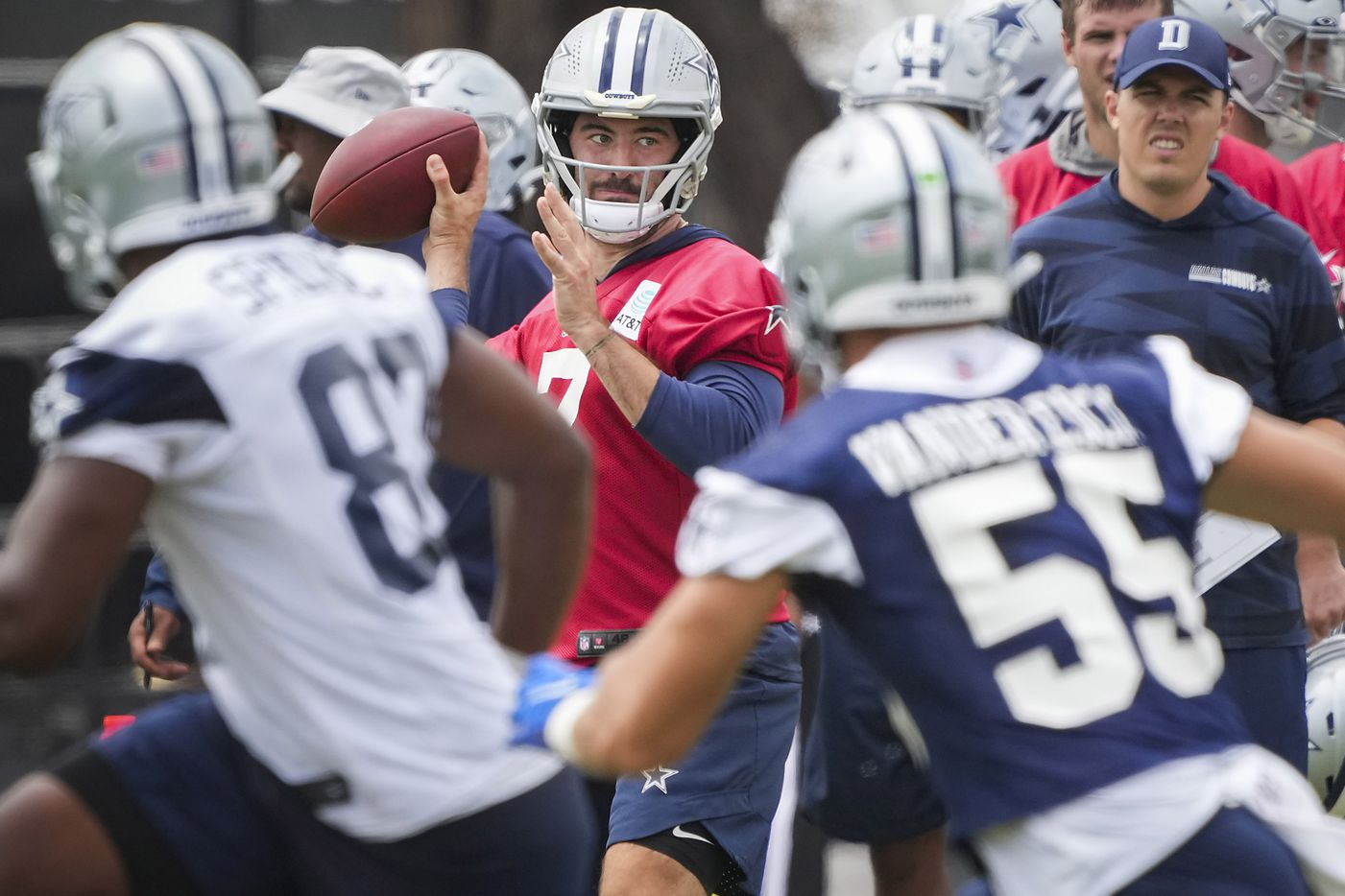 Dallas Cowboys quarterback Ben DiNucci (7) looks to pass as linebacker Leighton Vander Esch (55) covers wide receiver Brennan Eagles (83) while offensive coordinator Kellen Moore looks on during a practice at training camp on Sunday, July 25, 2021, in Oxnard, Calif.