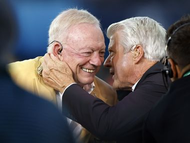 Dallas Cowboys owner Jerry Jones (left) and his former head coach Jimmy Johnson embrace on the FOX Sports broadcast before the Dallas Cowboys Pittsburgh Steelers preseason game at Tom Benson Hall of Fame Stadium in Canton, Ohio, Thursday, August 5, 2021. Johnson will be inducted into the Hall of Fame Saturday.