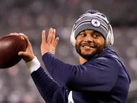 Dallas Cowboys quarterback Dak Prescott warms up before an NFL football game against the Chicago Bears at Soldier Field on Thursday, Dec. 5, 2019, in Chicago.