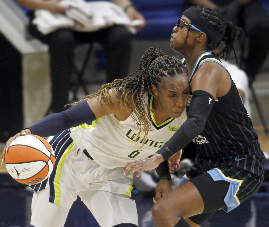 Dallas Wings forward Kayla Thornton (6) drives into the defense of Chicago Sky guard Diamond DeShields (1) during first half action. The two WNBA teams played their game at College Park Center in Arlington on July 2, 2021. (Steve Hamm/ Special Contributor)