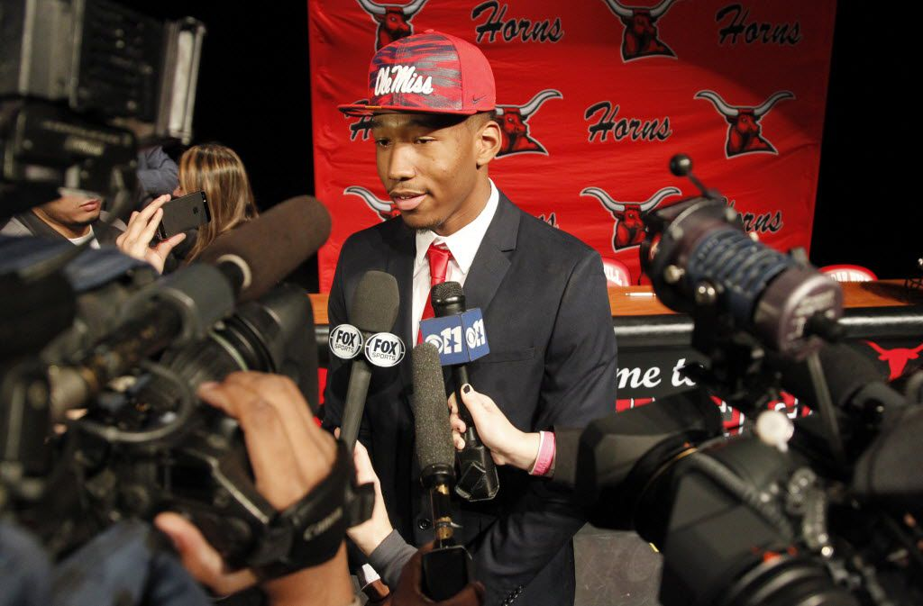 Cedar Hill wide receiver DaMarkus Lodge talks to the media about his decision to play for Ole Miss during National Signing Day at Cedar Hill High School in Cedar Hill, Texas, on Feb 4, 2015. (Michael Ainsworth/The Dallas Morning News)