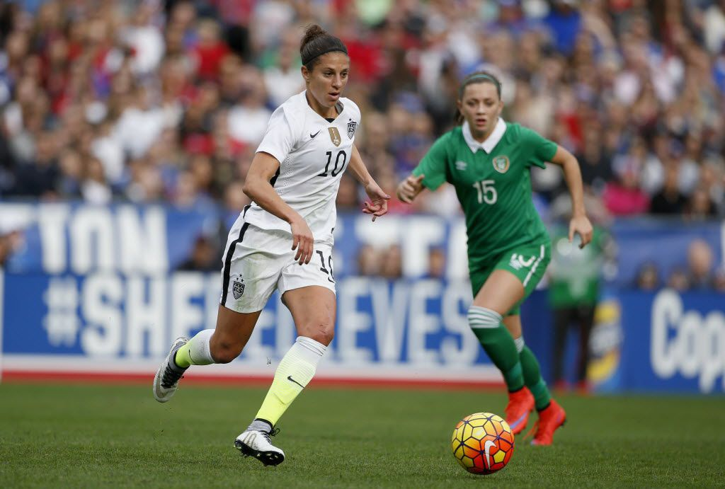 SAN DIEGO, CA - JANUARY 23:  Carli Lloyd #10 of the United States is defended by Katie McCabe #15 of Ireland at Qualcomm Stadium on January 23, 2016 in San Diego, California.  (Photo by Todd Warshaw/Getty Images)