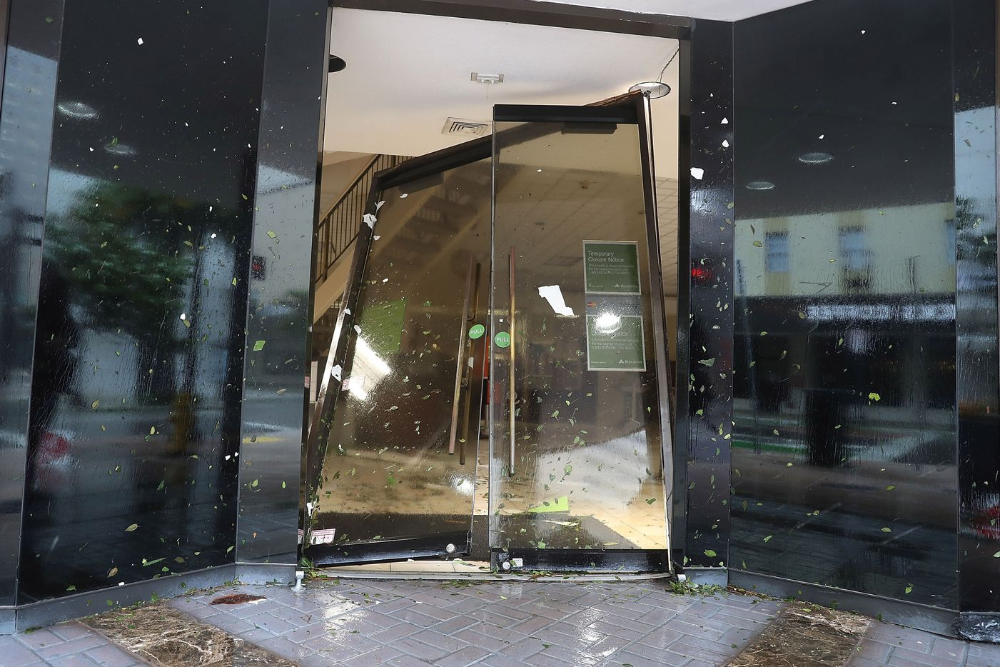 A door is seen blown in at a Regions Bank as Hurricane Irma passes through on September 10, 2017 in Miami, Florida. Hurricane Irma made landfall in the Florida Keys as a Category 4 storm on Sunday, lashing the state with 130 mph winds as it moves up the coast.