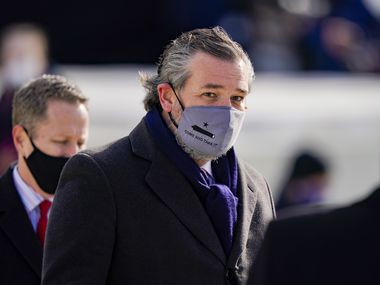 "Sen. Ted Cruz, wearing a face mask that reads ""Come and Take It,"" arrives to the inauguration of President Joe Biden on the West Front of the U.S. Capitol on January 20, 2021."