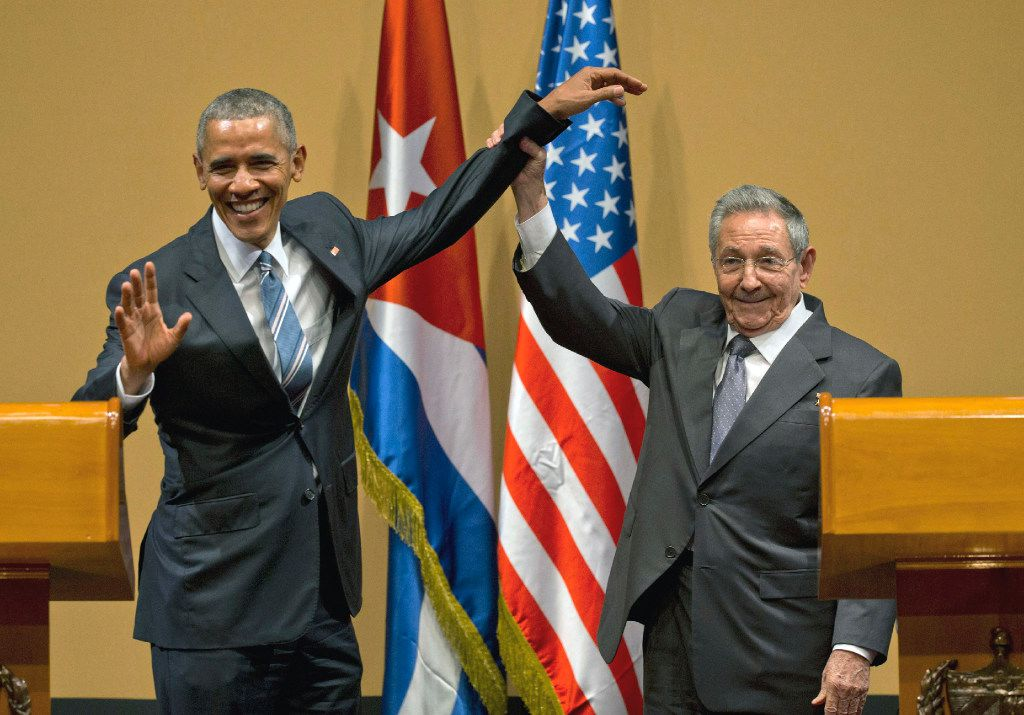 FILE - In this March 21, 2016 file photo, Cuban President Raul Castro, right, lifts up the arm of U.S. President Barack Obama, at the conclusion of their joint news conference at the Palace of the Revolution, in Havana, Cuba. Next year will likely be Castro's toughest year in office since he took power in 2006, as the 85-year-old general faces a possible economic recession alongside a hostile new U.S. administration promising to undo measures that gave many Cubans expectations of a better future. (AP Photo/Ramon Espinosa, File)