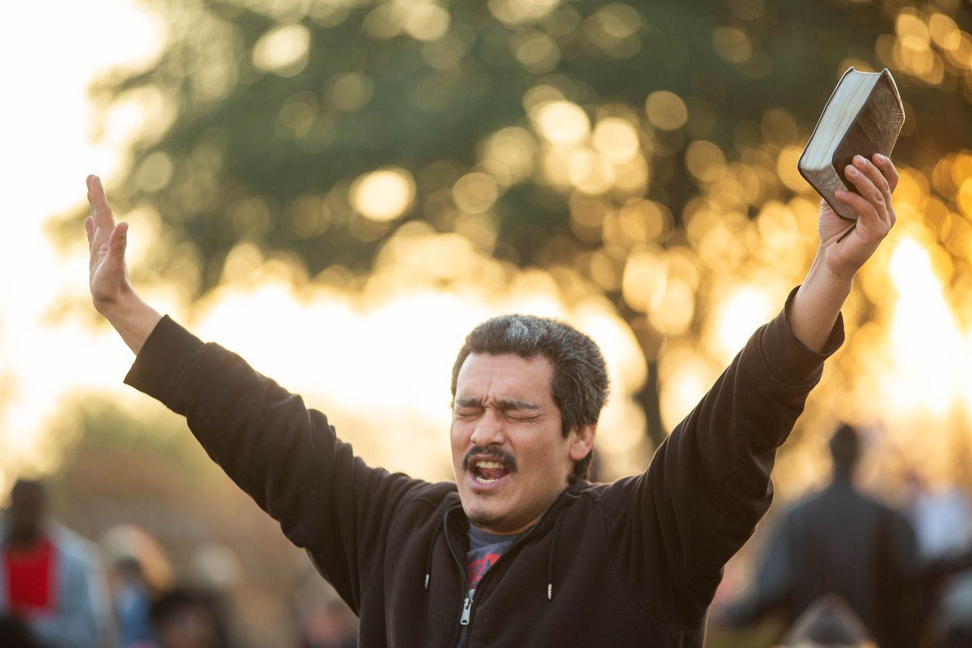 Carlos Pena sang along to worship music at S.O.U.L. Church in downtown Dallas on Dec. 8, 2019.