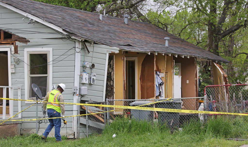 An Atmos worker investigated a house explosion in the 3700 block of Spring Avenue near Fair Park in April 2018.