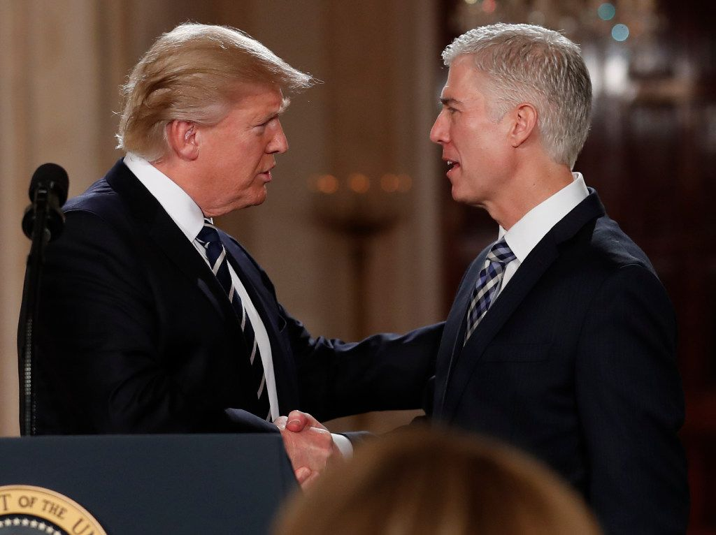 President Donald Trump shakes hands with 10th U.S. Circuit Court of Appeals Judge Neil Gorsuch, his choice for Supreme Court Justices in the East Room of the White House in Washington, Tuesday, Jan. 31, 2017. (AP Photo/Carolyn Kaster)