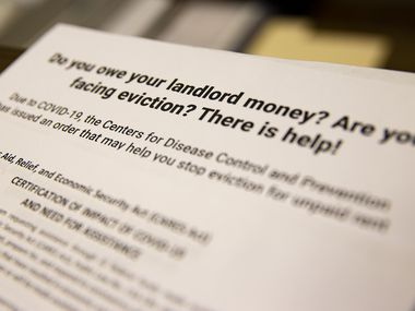 Informational handouts about eviction help are shown at Harmony Community Development Center in Dallas.