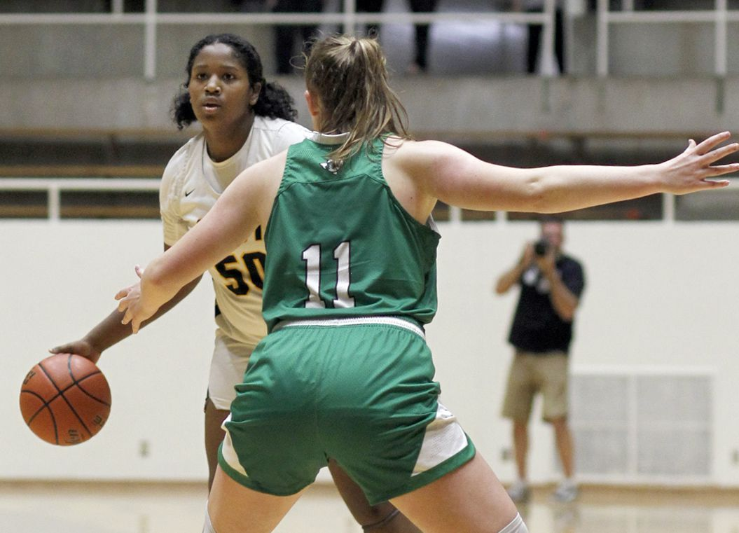 Plano East forward Taylor Haggan (50) brings the ball to the top of the key as she is defended by Southlake Carroll guard Kaelyn Riley (11) during first half action. Plano East won 56-42 to advance. The two teams played their Class 6A regional semifinal girls playoff basketball game at Loos Field House in Addison on February 27, 2021. (Steve Hamm/ Special Contributor)