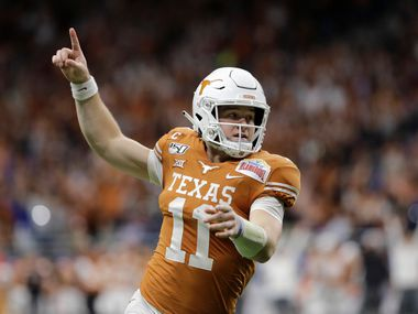 Texas quarterback Sam Ehlinger celebrates a touchdown against No. 11 Utah during the first half of the Longhorns' 38-10 Alamo Bowl victory in San Antonio, Tuesday, Dec. 31, 2019. (AP Photo/Austin Gay)