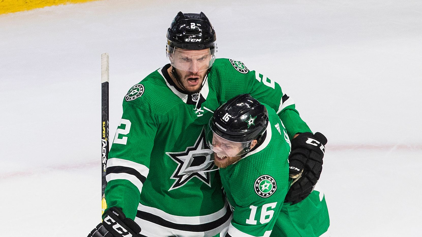 Dallas Stars' Jamie Oleksiak (2) and Joe Pavelski (16) celebrate a goal against the Calgary Flames during the third period of a first round NHL Stanley Cup playoff hockey series in Edmonton, Alberta, on Thursday, Aug. 13, 2020.