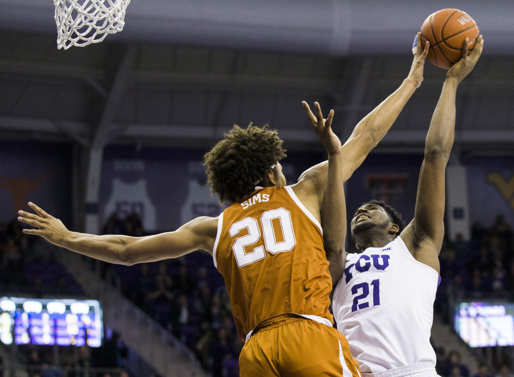 TCU Horned Frogs center Kevin Samuel (21) has his shot blocked by Texas Longhorns forward Jericho Sims (20) during the first half of an NCAA men's basketball game between the University of Texas and TCU on Wednesday, January 29, 2020 at Schollmaier Arena on the TCU campus in Fort Worth.