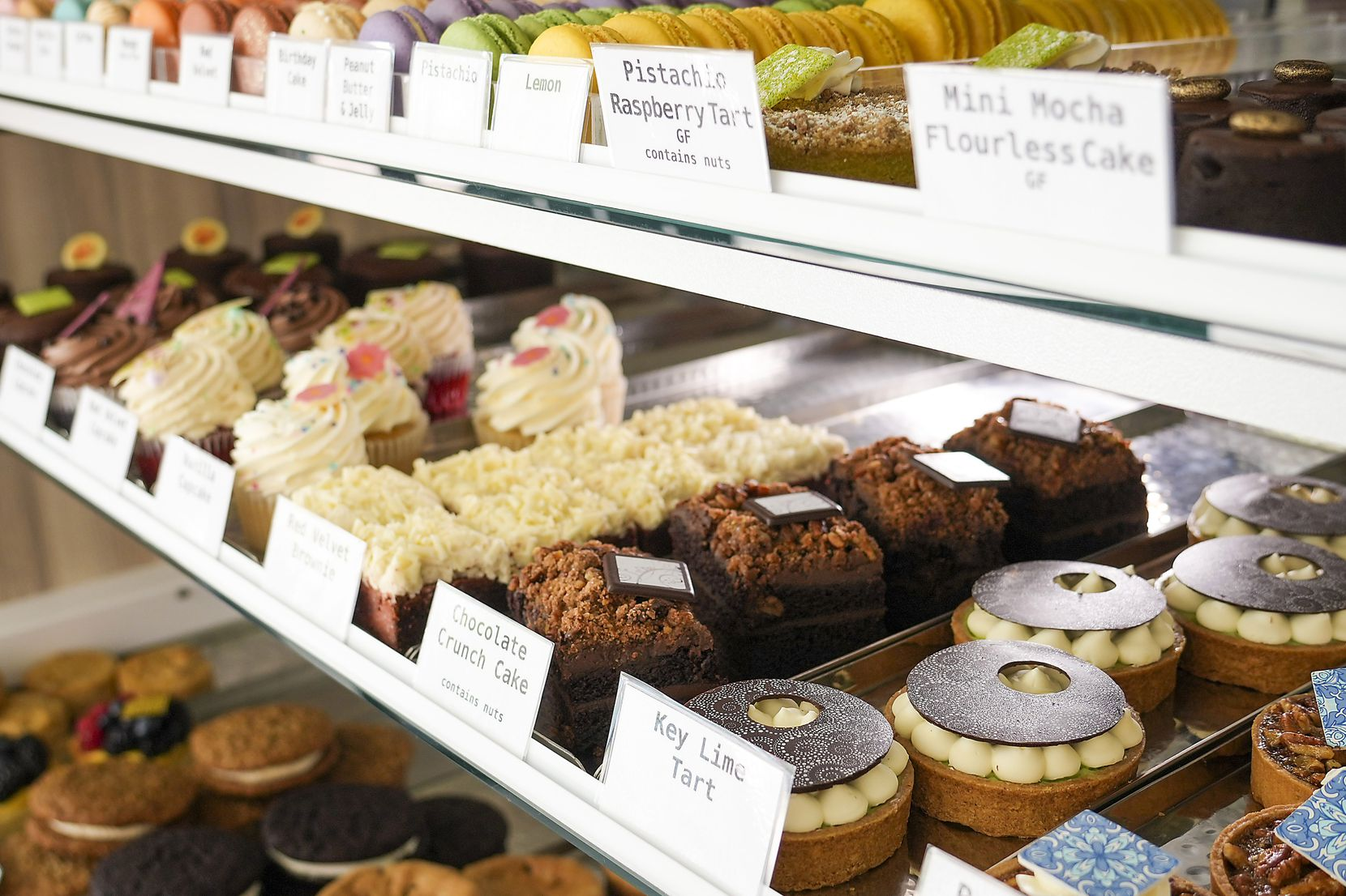 Cakes, cookies, tarts and macrons in a display case at Haute Sweets Patisserie in Hillcrest Village (Smiley N. Pool/The Dallas Morning News)