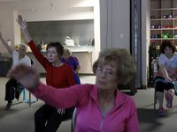 Wendy Ricks (left) and Gay Vanwart (right) practiced yoga with a group of senior citizens through the Silver Sneakers fitness program in 2016 at the Texas Health Finley Ewing Cardiovascular & Fitness Center in Dallas.