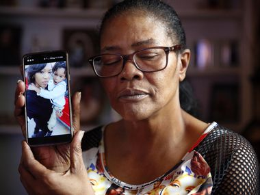 Tammy Kirk, mother of LaTiffiney Rodgers who was fatally shot and her sons were the subject of an Amber Alert, is photographed in her Cedar Hill home. She is holding a photo on her phone of LaTiffany and her oldest son, 7-year-old Jorden Rodgers.