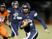 Frisco Lone Star quarterback Garrett Rangel (13) carries the ball against Lancaster during the first half of their Class 5A Division I Regional championship game at Wilkerson-Sanders Stadium in Rockwall, Texas, Friday, December 6, 2019.