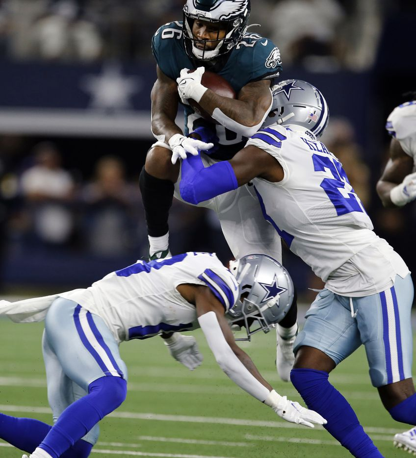 Philadelphia Eagles running back Miles Sanders (26) is stopped by the dallas defense, including Dallas Cowboys safety Jayron Kearse (27) during the first half of a NFL football game at AT&T Stadium in Arlington on Monday, September 27, 2021. (John F. Rhodes / Special Contributor)