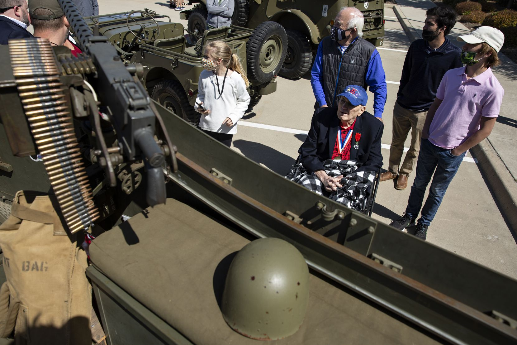 From left, Mercer Neilon, 11, Bill Richards, Burnie Sutter, Jensen Morey, and Brett Richards, 14, check out an old military vehicle during the parade.