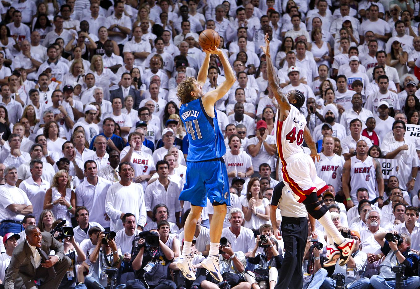 Dallas Mavericks power forward Dirk Nowitzki (41) puts up a jumper along the baseline late in the fourth quarter as Miami Heat power forward Udonis Haslem (40) tries to get a hand in his face in game six of the NBA Finals at American Airlines Arena Sunday, June 12, 2011 in Miami   (Tom Fox/The Dallas Morning News) 06162011xQUICK ORG XMIT: DMN1106130307261873