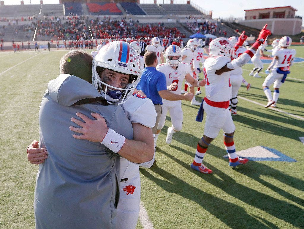 Parish Episcopal's Preston Stone (2) hugs head coach Daniel Novakov in celebration after defeating Plano John Paul II 42-14 in the TAPPS Division I State Championship game at Waco Midway's Panther Stadium in Hewitt, Texas on Friday, December 6, 2019. (Vernon Bryant/The Dallas Morning News)
