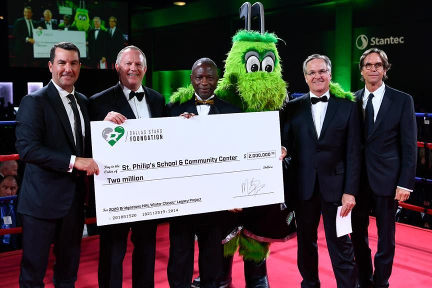 Dallas Stars Foundation pledged $2 million to support St. Philip's School. Headmaster Dr. Terry Flowers (third from left) receives the check.