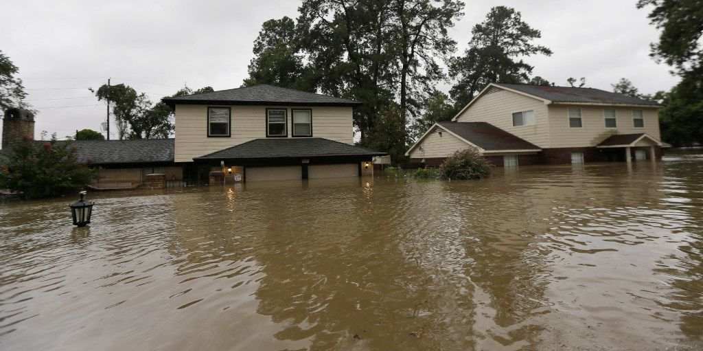 Floodwaters from Harvey surrounded homes Monday in Spring. (David J. Phillip/The Associated Press)