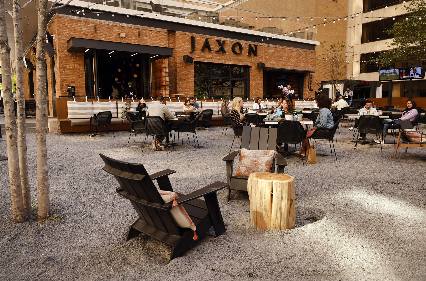 Visitors gather at the indoor and outdoor dining and entertainment area in the new AT&T Discovery District in downtown Dallas,