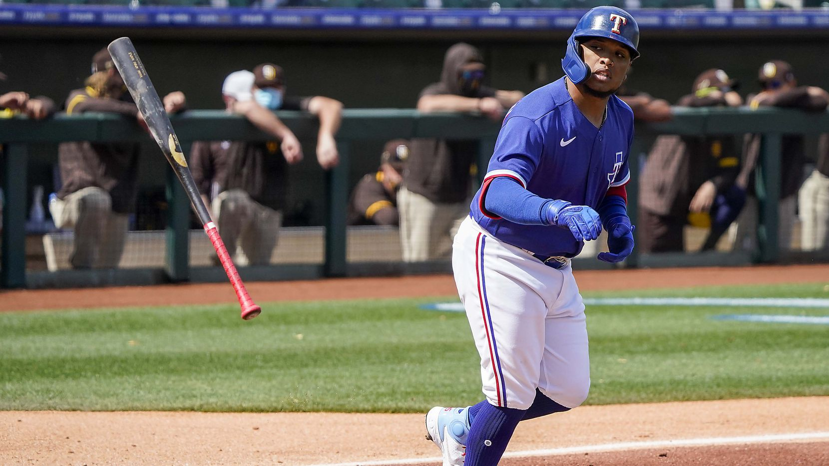 Texas Rangers outfielder Willie Calhoun heads for first base after drawing a walk during the first inning of a spring training game against the San Diego Padres at Surprise Stadium on Thursday, March 4, 2021, in Surprise, Ariz.
