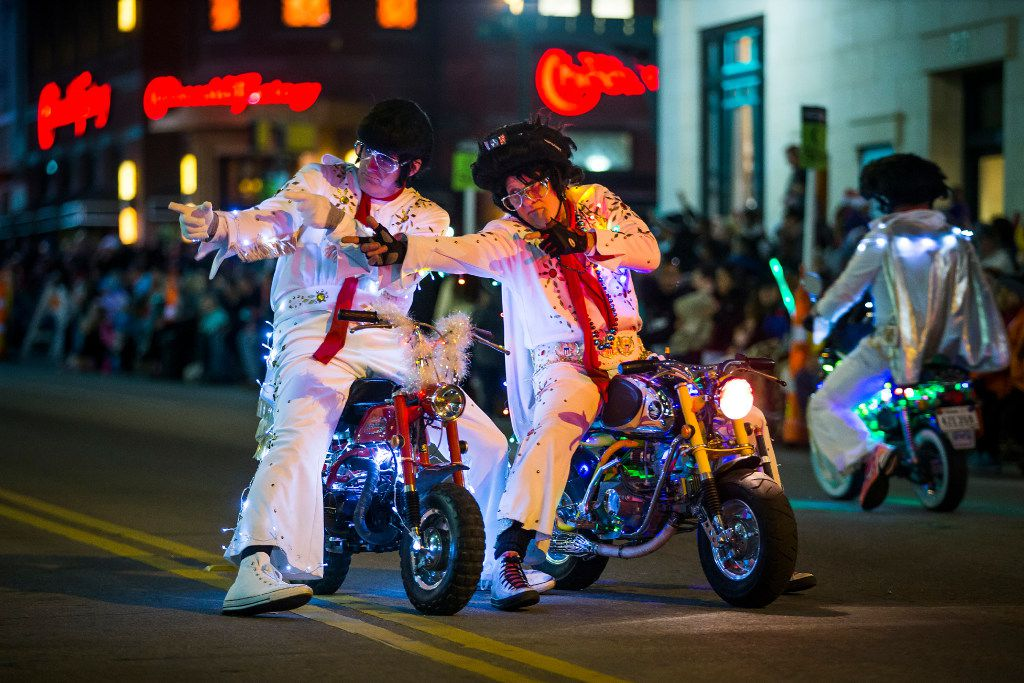 The World Famous Wheelie-ing Elvi make a return trip to the GM Financial Parade of Lights in Fort Worth. (Smiley N. Pool/The Dallas Morning News)