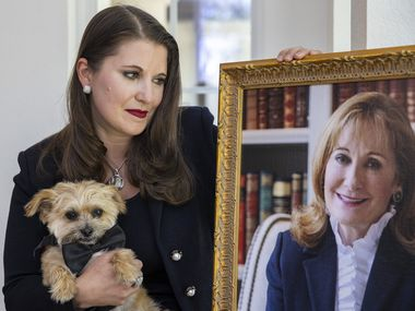 """Courtney Underwood and her service dog, Brooks, with a photograph of her late mother, Nancy Elizabeth Underwood.  Courtney said that when her mother died by suicide, """"All the compartmentalized boxes that I had filed away my PTSD and my trauma into just fell apart."""""""