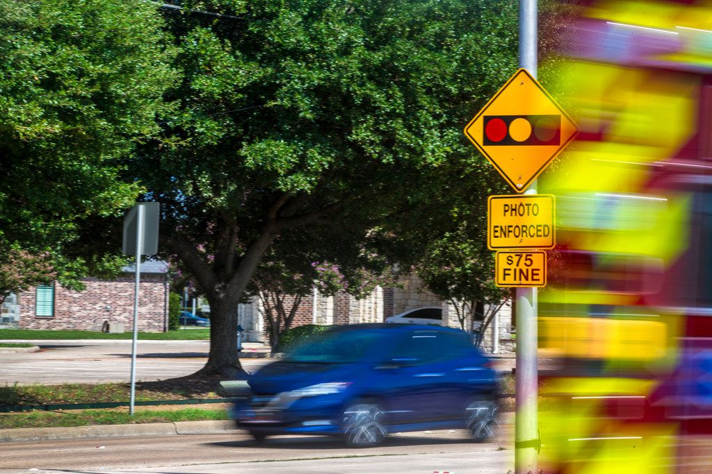 A sign warning drivers of the red light cameras at the intersection of West Spring Creek Parkway and Custer Road in Plano. Plano has a total of 25 cameras at 17 intersections. A bill to ban red light cameras passed in the Texas House Committee on Transportation on April 17, 2019.