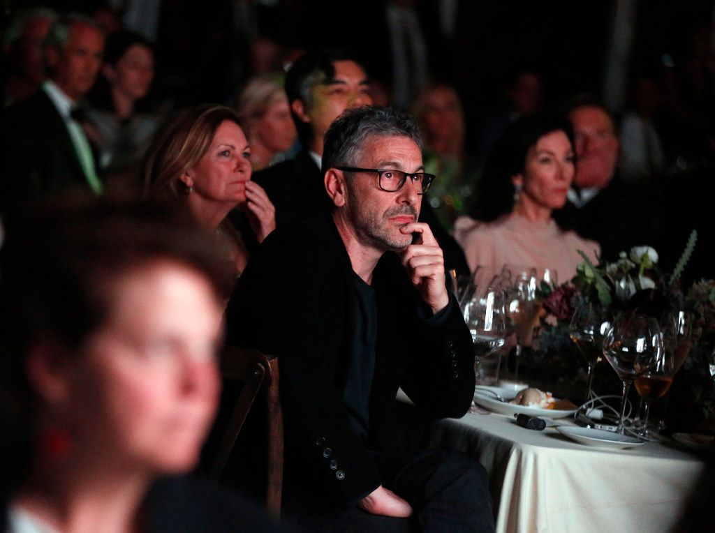French artist Pierre Huyghe watches a short film about himself before being honored with the Nasher Prize during a gala at the Nasher Sculpture Center in Dallas, Saturday, April 1, 2017. (Tom Fox/The Dallas Morning News)